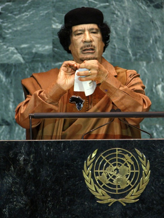 Libyan leader Gaddafi pretends to rip a charter as he addresses the 64th United Nations General Assembly at the U.N. headquarters in New York