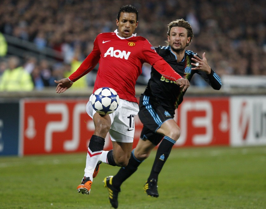 Olympique Marseille's Heinze challenges Manchester United's Nani during their Champions League soccer match at the Velodrome Stadium in Marseille