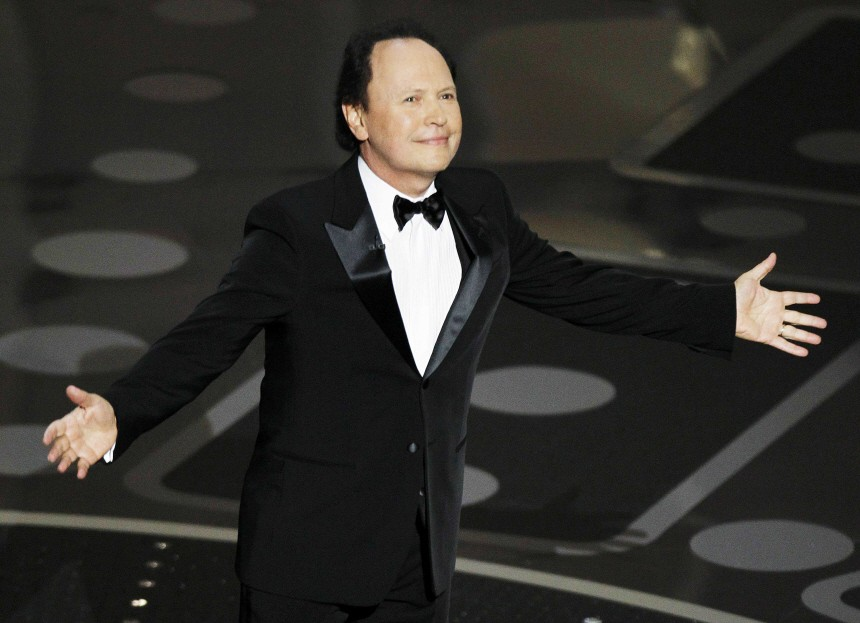Presenter Billy Crystal stands on stage during the 83rd Academy Awards in Hollywood