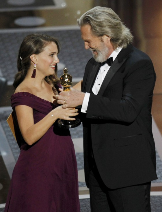 Natalie Portman accepts the Oscar for best actress from presenter Jeff Bridges during the 83rd Academy Awards in Hollywood