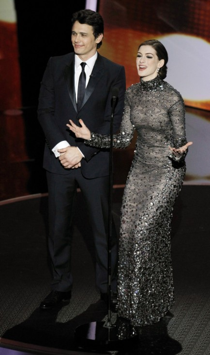 Co-hosts James Franco and Anne Hathaway talk on stage during the 83rd Academy Awards in Hollywood