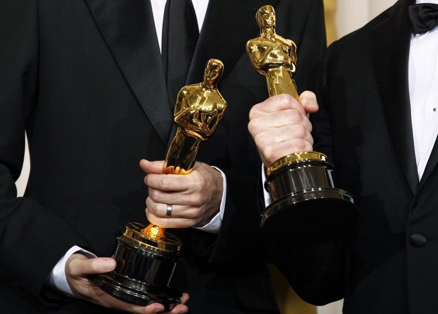Oscar winners Ross and Reznor pose backstage at the 83rd Academy Awards in Hollywood