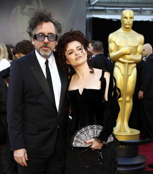 British actress Helena Bonham Carter and director Tim Burton arrive at the Academy Awards in Hollywood