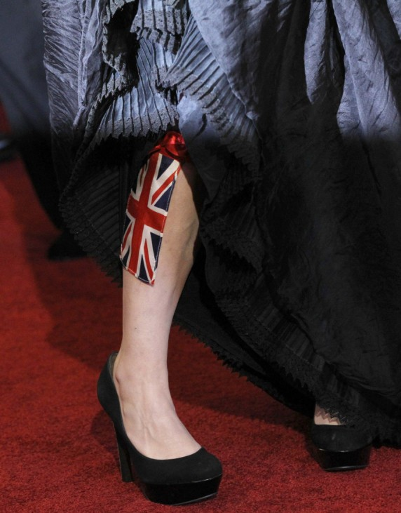 British actress Helena Bonham Carter, best supporting actress nominee for her role in 'The King's Speech', shows off the Union Jack attached to leg as she arrives at the 83rd Academy Awards in Hollywood