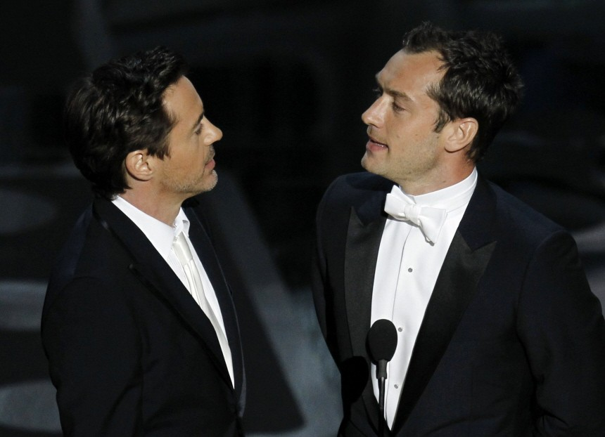 Presenters Robert Downey Jr. and Jude Law take the stage during the 83rd Academy Awards in Hollywood