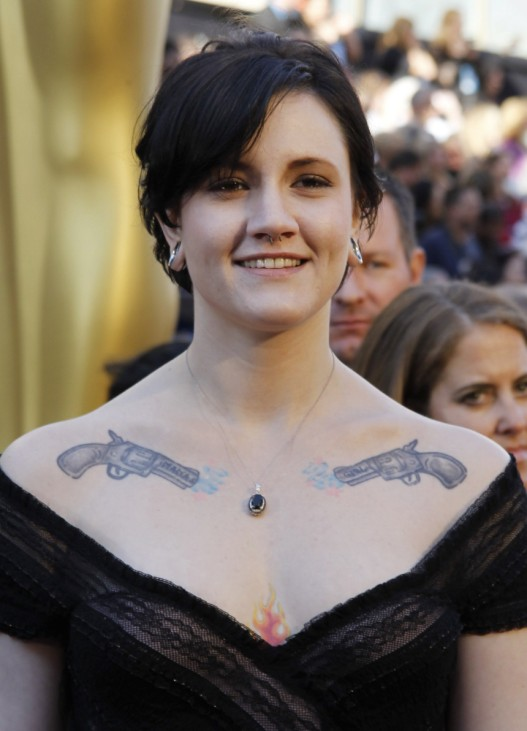 Murray, subject in 'Poster Girl' nominated in documentary short subject, is seen with tattoo as she arrives at the 83rd Academy Awards in Hollywood