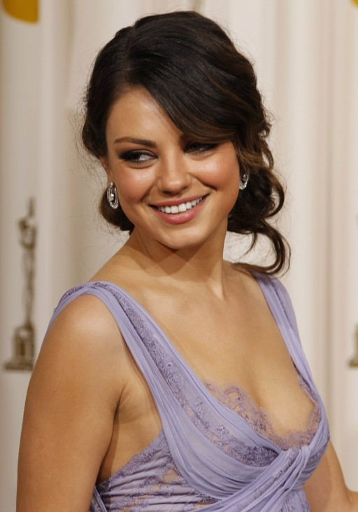 Actress Mila Kunis poses backstage at the 83rd Academy Awards in Hollywood