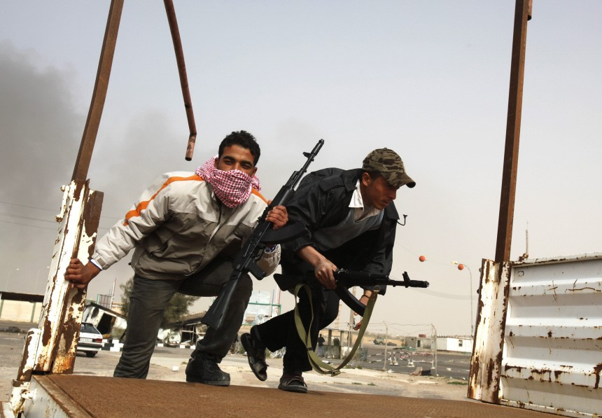 Anti-government tribal rebels prepare for possible attacks by pro-Gaddafi loyalists at a checkpoint in Ajdabiya