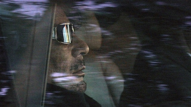 Libyan leader Muammar Gaddafi arrives in a car to the Boticaria ranch outside Seville