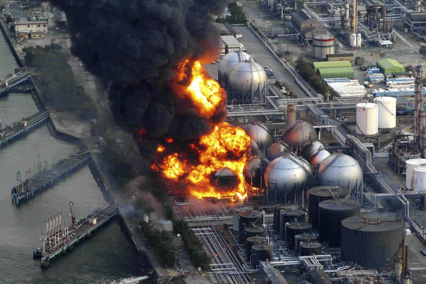 Natural gas storage tanks burn at Cosmo oil refinery in Ichihara city