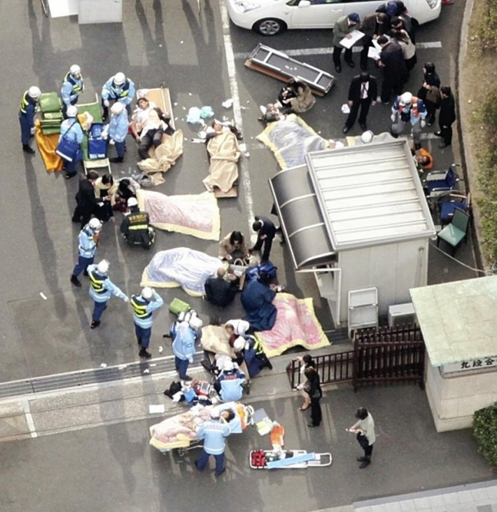 Rescue workers attend to injured people in Tokyo