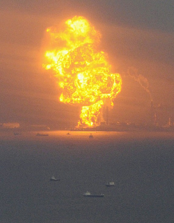 Natural gas containers burn at a facility following an earthquake in Chiba Prefecture near Tokyo