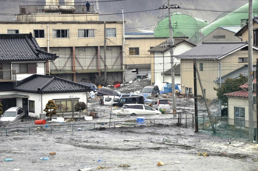 Streets are flooded after a tsunami and earthquake in Kesennuma city