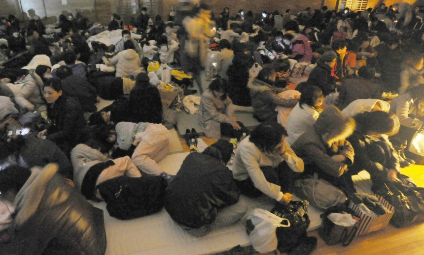 Evacuees take shelter at an evacuation centre after an earthquake and tsunami in Sendai, northeastern Japan
