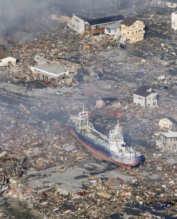 A ship tossed up onto city streets by a tsunami after an earthquake is pictured in Kesennuma City, Miyagi Prefecture