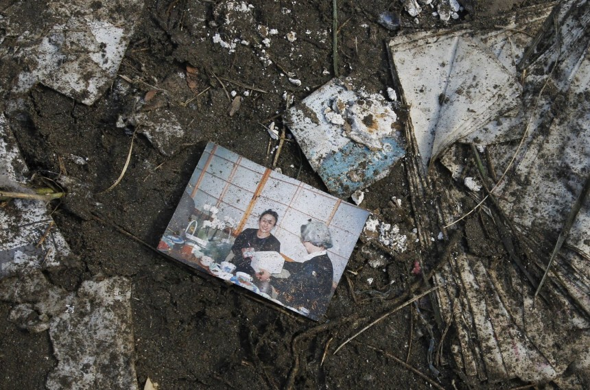 A family photograph is seen among the rubble after a tsunami and earthquake in Rikuzentakata, northern Japan