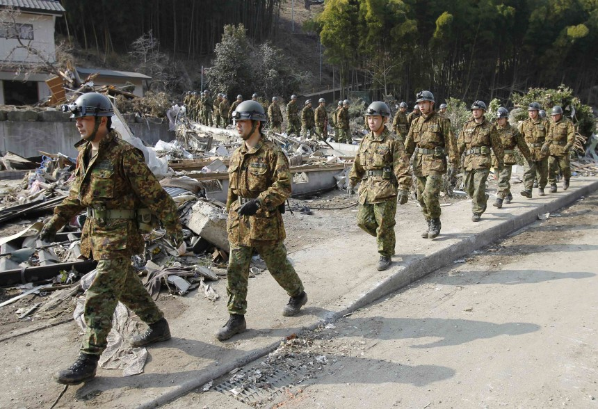 Soldiers from Japan's Self Defence Force arrive at the scene of devastation in Rikuzentakata