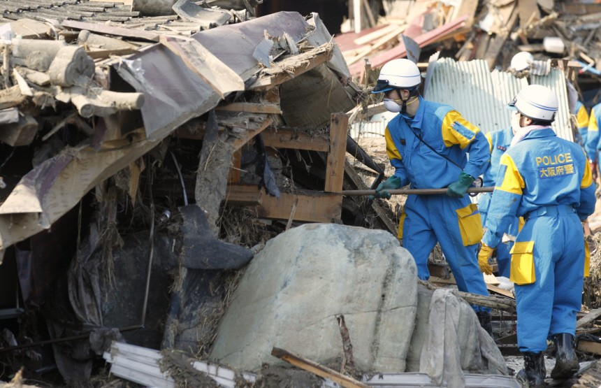 Rescue workers search for victims in the rubble in Rikuzentakata, northern Japan after the magnitude 8.9 earthquake and tsunami struck the area
