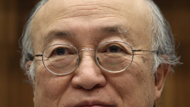 International Atomic Energy Agency IAEA Director General Amano smiles as he prepares for a Board of Governors meeting at the IAEA headquarters in Vienna