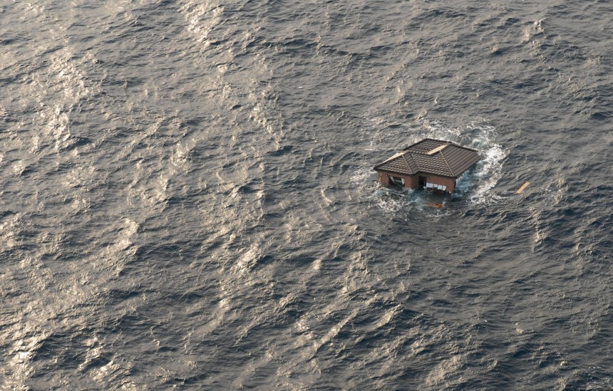Sea Hawk helicopter conducting a search of debris fields in the w