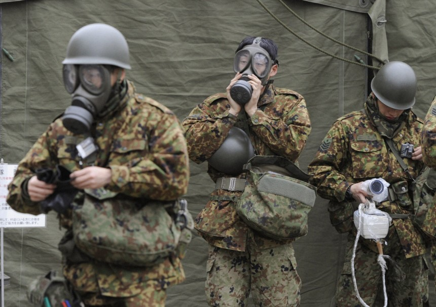 Japan Self-Defense Force officers prepare for a clean-up at a radiation affected area in Nihonmatsu