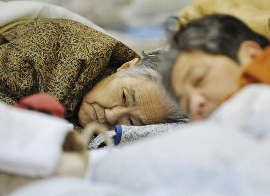 People rest at a shelter for earthquake and tsunami evacuees in Miyako city