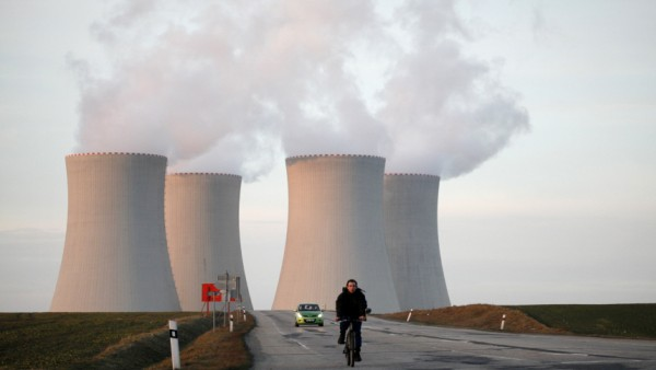 A man rides his bicycle away from the the cooling towers of the Temelin nuclear power plant near Tyn nad Vltavou