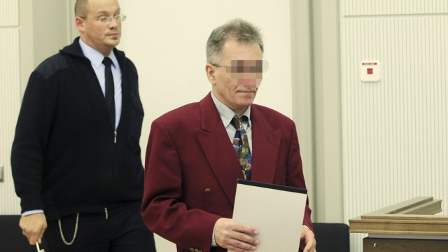 Defendant Detlef S. arrives for the continuation of his trial at the district court in Koblenz
