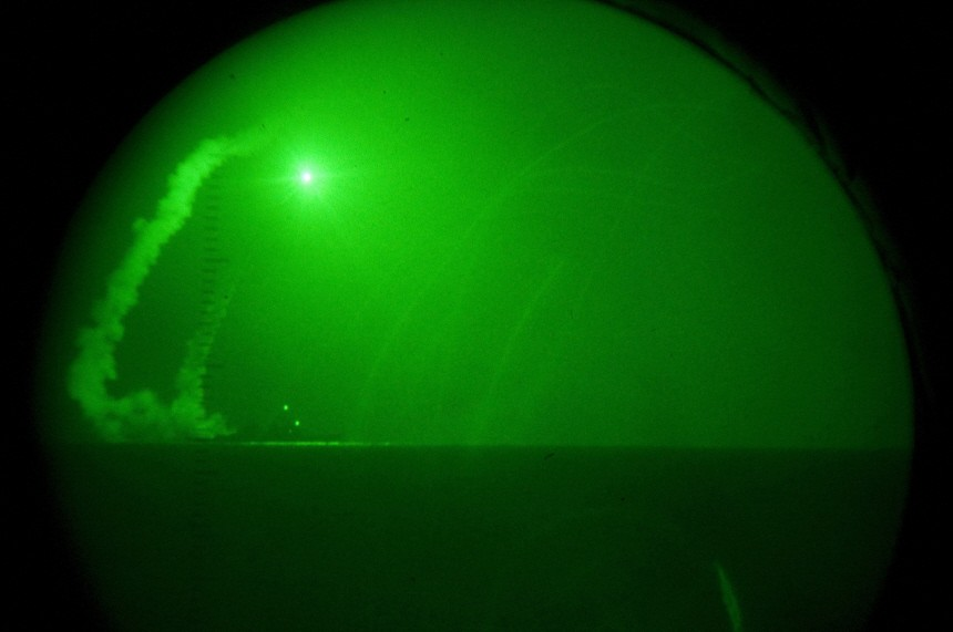 View through night-vision lenses of Tomahawk cruise missiles being fired in the Mediterranean Sea