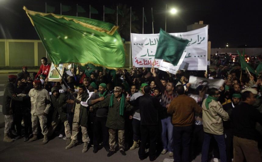 Supporters of Libya's leader Muammar Gaddafi shout slogans during a protest outside Bab Al-Aziziyah