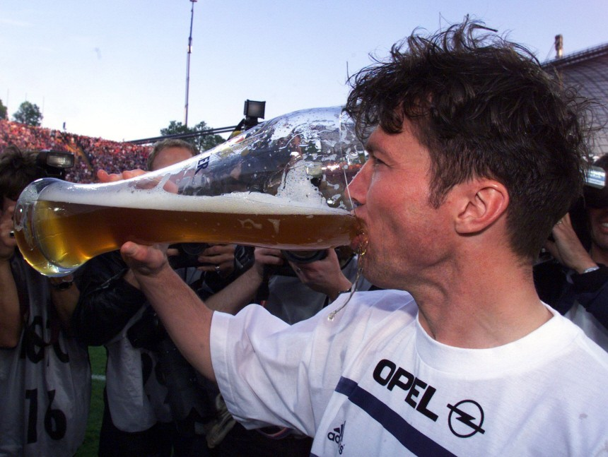LOTHAR MATTHAEUS DRINKS A LARGE GLASS OF BEER TO CELEBRATE BAYERN MUNICH'S LEAGUE TITLE