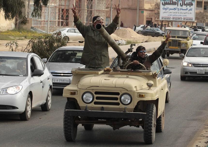 Rebels celebrate on a street in Benghazi