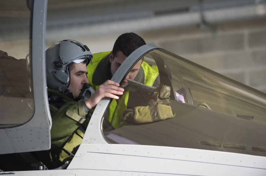A French Air Force pilot, seen in this photo released by ECPAD, prepares for a mission to overfly Libya aboard a Rafale combat aircraft at the Saint-Dizier airbase