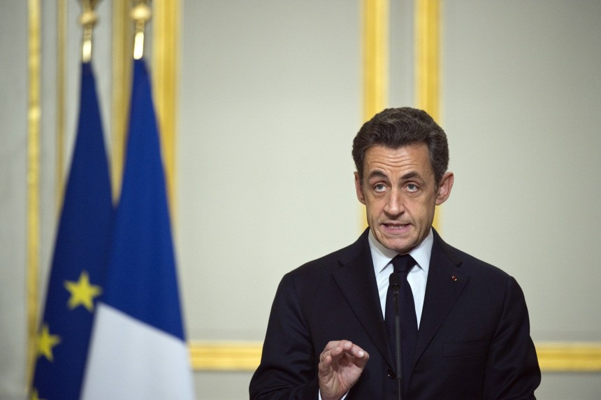 France's President Sarkozy delivers a speech at the Elysee Palace after international talks on Libya in Paris