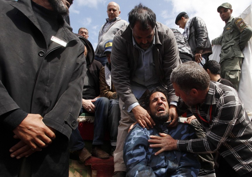 Mourner reacts during the funeral of a Libyan killed by forces loyal to Libyan leader Muammar Gaddafi in Benghazi