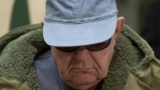 Accused Nazi death camp guard Demjanjuk arrives in a courtroom in Munich