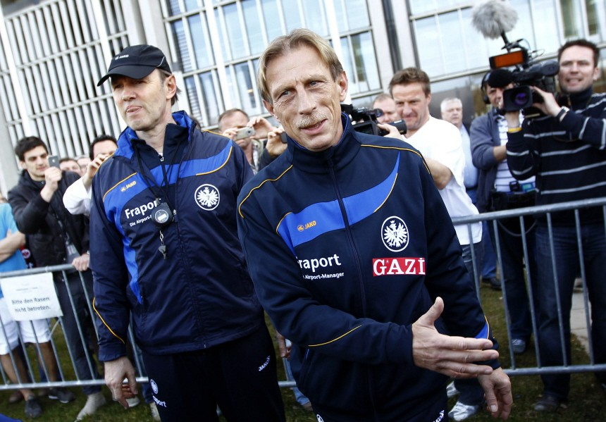 Eintracht Frankfurt's new coach Daum (R) and his assistant Koch arrive on the training ground prior to their first training session after Daum's official presentation in Frankfurt