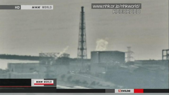 Smoke rises from the nuclear reactors of Fukushima Daiichi nuclear power plant in Tomioka, Fukushima prefecture, northeastern Japan,