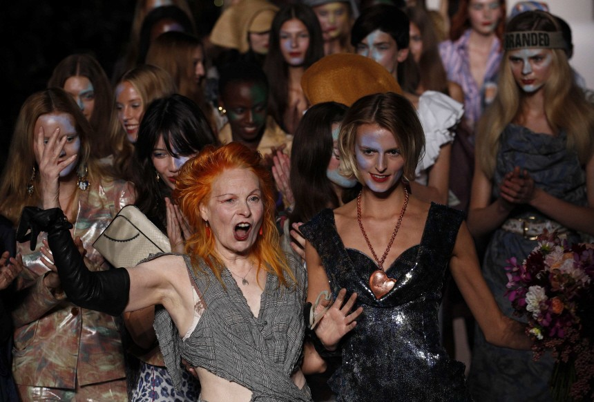 Fashion designer Westwood walks down the catwalk with her models following the presentation of her 2010 Spring/Summer collection at London Fashion Week