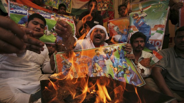 Fans attend a special prayer ceremony for the victory of Indian cricket team in Jammu