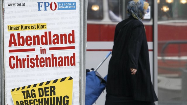 A woman passes an Austrian Freedom Party (FPOe) controversial European parliament election campaign poster in Vienna