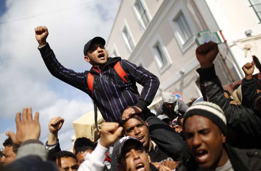 People who fled the unrest in Tunisia protest against conditions on the southern Italian island of Lampedus