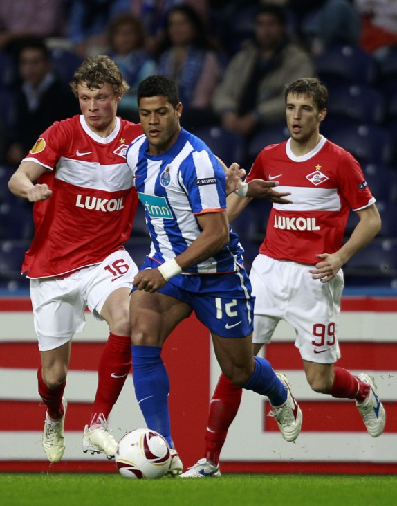 Porto's Hulk battles for the ball with Spartak Moscow's Makeev and Kombarov during their Europa League quarter-final first leg soccer match in Porto