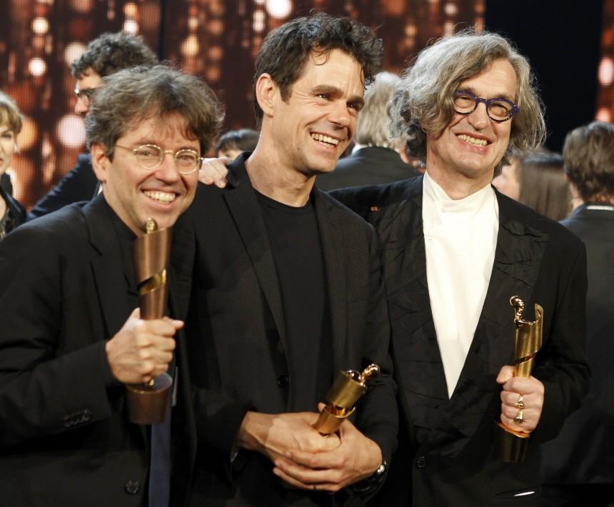 German directors Wenders, Tykwer and Veiel hold their awards during the German Film Prize (Lola) ceremony in Berlin