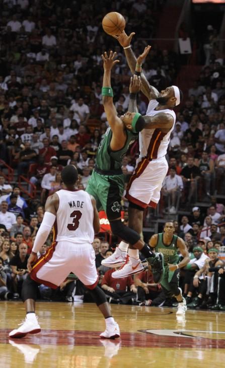 Miami Heat Wade and LeBron James defend Boston Celtics Paul Pierce during their NBA basketball game in Miami.