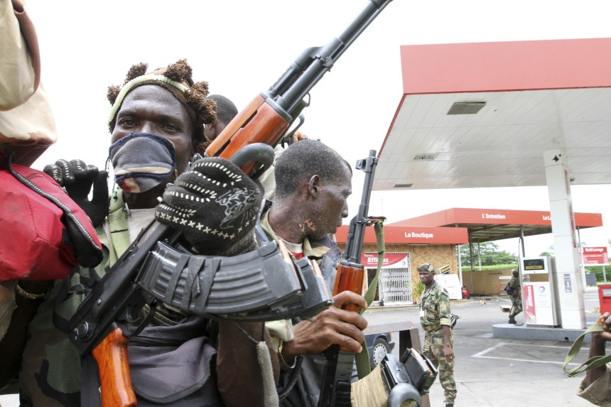 FRCI soldiers who support Ivory Coast's President Ouattara are seen at a petrol station in the Cocody district of Abidjan