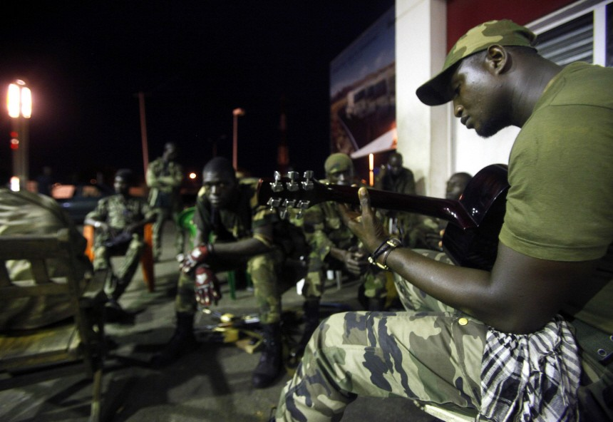 Forces loyal to Ivorian President Alasane Ouattara relax at a military base in Abidjan