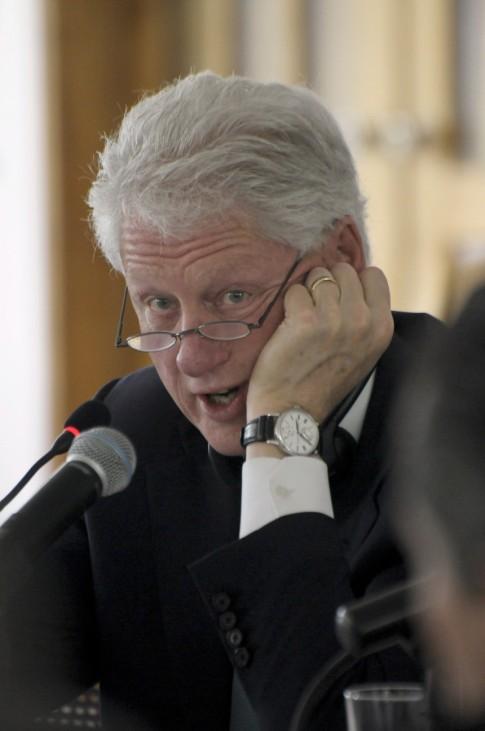 Former U.S. President Clinton speaks during board meeting with members of IHRC in Port-au-Prince