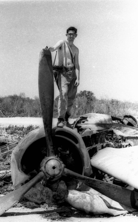 File photo of a soldier of the Cuban Armed Forces atop a downed B-26 bomber
