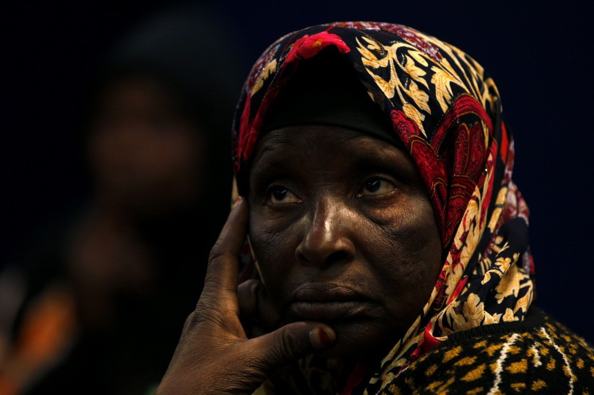 A Ghanaian migrant worker onboard the Greek ferry 'Ionian Spirit' waits to disembark in the port of Benghazi
